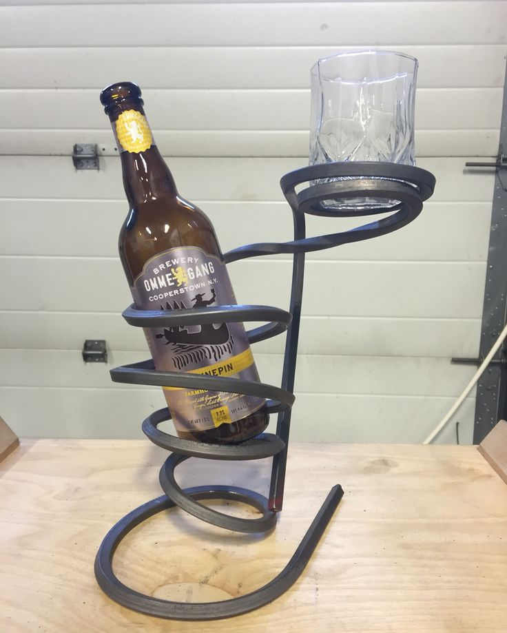 """3/8"""" square, 10 foot bar bent into a perfectly balanced bottle and glass holder. No heat or tools used. 100% hand bent!"""