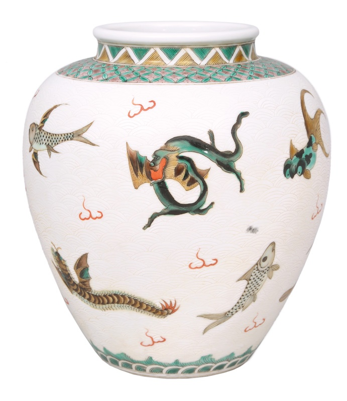 A rare shoulderneck-vase with exceptional fish-decoration China, prob. 18th cent. (Qing-dynasty 1644-1911). Porcelain with polychrome painting, mostly in green and brown. Ovoid body with small and slightly reversed rim. The wall with a very fine painting of different animals (mostly sea animals, combined with dragons and a deer) on a subtle white scoring-decoration. The shoulder with a fine lined grid-border. Double circle mark.