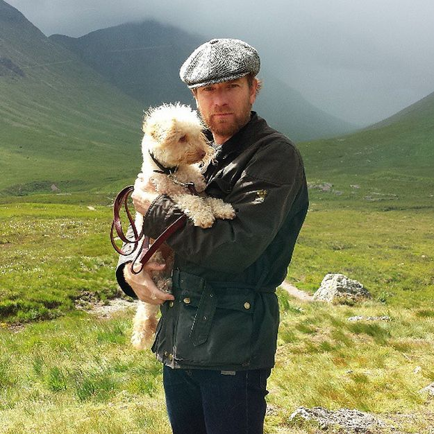 First, look at this photo of Ewan in a newsboy cap holding his dog with majestic greens around him. | 22 Steps To Tranquility As Told By Ewan McGregor's Instagram
