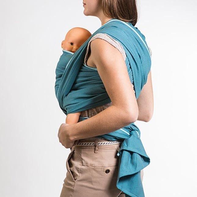Neobulle - Fascia Porta Bebè Lunga Rigida Blue Denim. Con la fascia porta bebè Neobulle puoi portare il tuo bambino dalla nascita ai 15 Kg (approssimativamente 3 o 4 anni di età). Confezionata con 100% cotone Oekotex certificato esente da residui chimici e sostanze nocive. Con la stessa fascia è possibile portare il bambino in molti modi, grazie alla possibilità di fare molte legature differenti