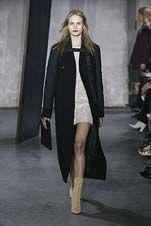 51-3.1 Phillip Lim Fall/Winter 2015/2016 Collection full length black coat over femme beige mini, pale mustard ankle boot