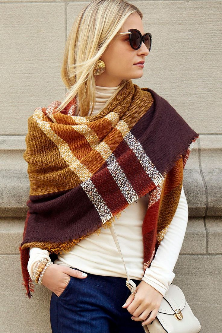 Must-have. A classic plaid print and frayed edges increase the rustic tone of this oversized square scarf. #shopversona