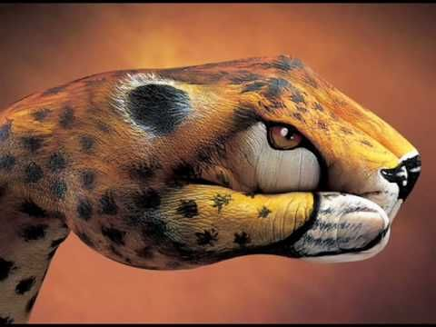 Wonderful hand painted artwork by Italian artist Guido Daniele set to the music of Queen - It's a kind of magic