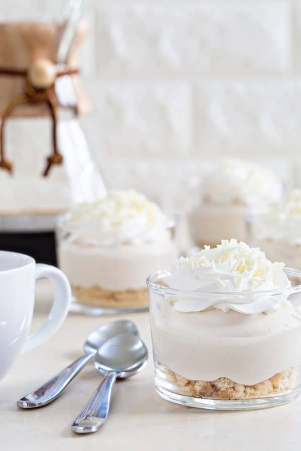 AD | White Chocolate Tiramisu Pudding Cups come together in minutes for a delicious and simple dessert. They're perfect for holiday parties, or even a special treat for yourself. Sponsored by New GODIVA Instant Pudding Mix.