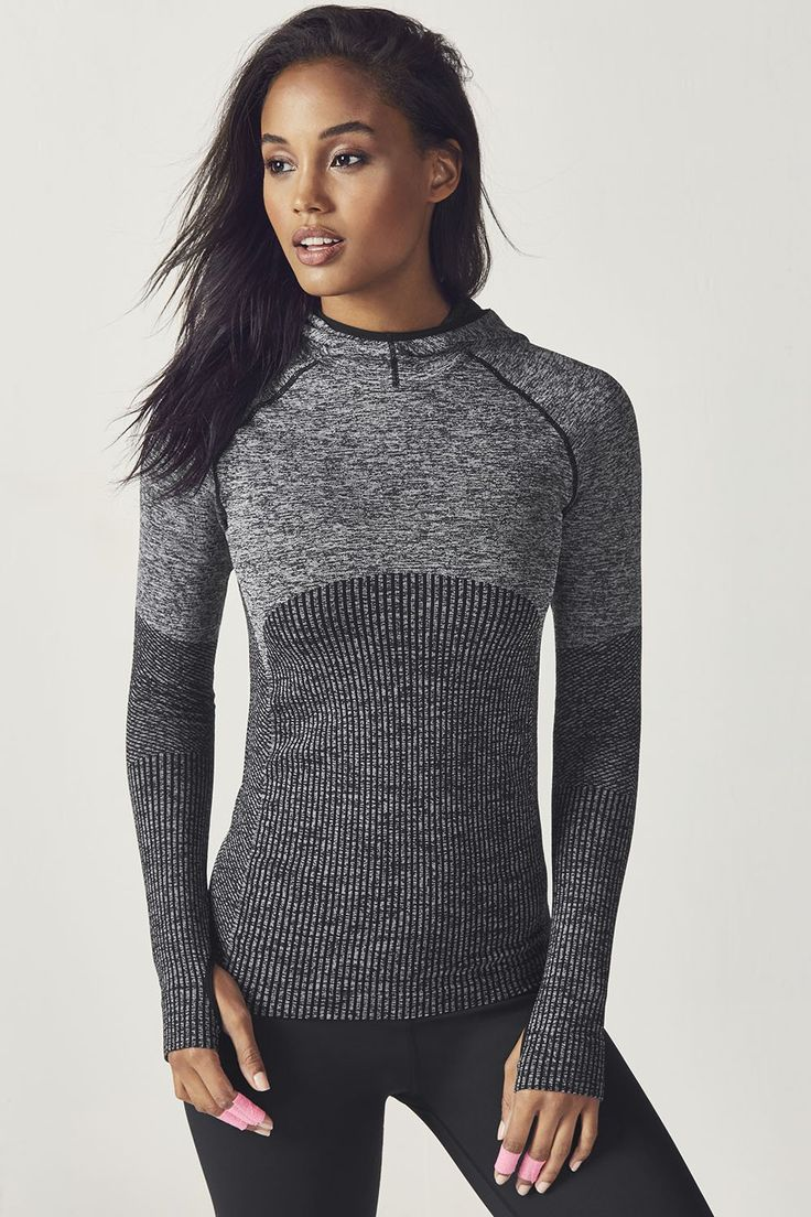 Layer up for the cooldown with our seamless, ribbed jacquard pullover, featuring moisture-control fabric and built-in thumbholes to keep your sleeves in place. | Fabletics Avaline Seamless L/S Hoodie