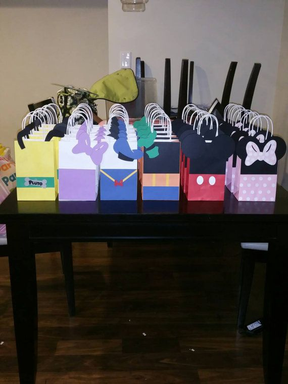 Hey, I found this really awesome Etsy listing at https://www.etsy.com/listing/248499386/party-bags Mickey mouse, mickey mouse clubhouse, mickey goody bags, minnie mouse, donald duck, daisy duck, pluto, goofy, party bags, party decor