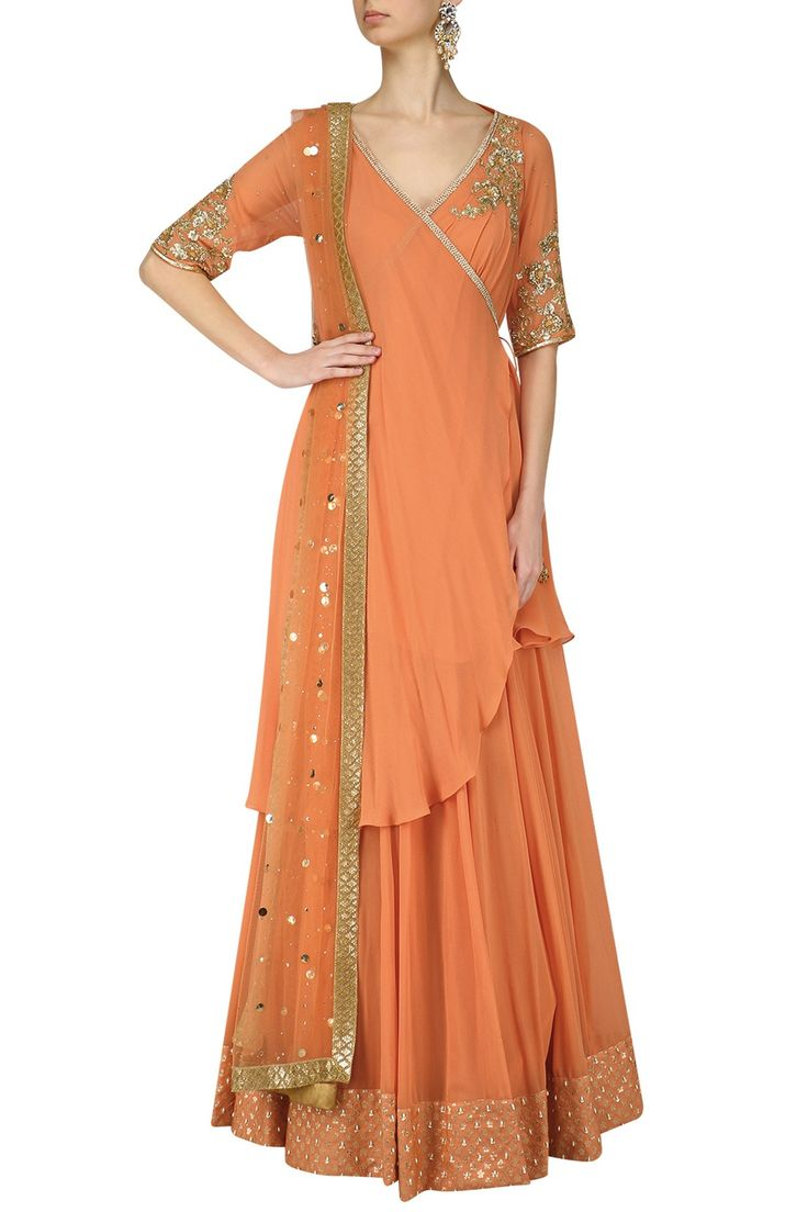 Dusky orange angrakha lehenga set available only at Pernia's Pop Up Shop.