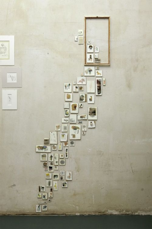 """Monja Gentschow installation art piece. Brilliant. Looks as if the pictures are escaping/travelling through the space."""