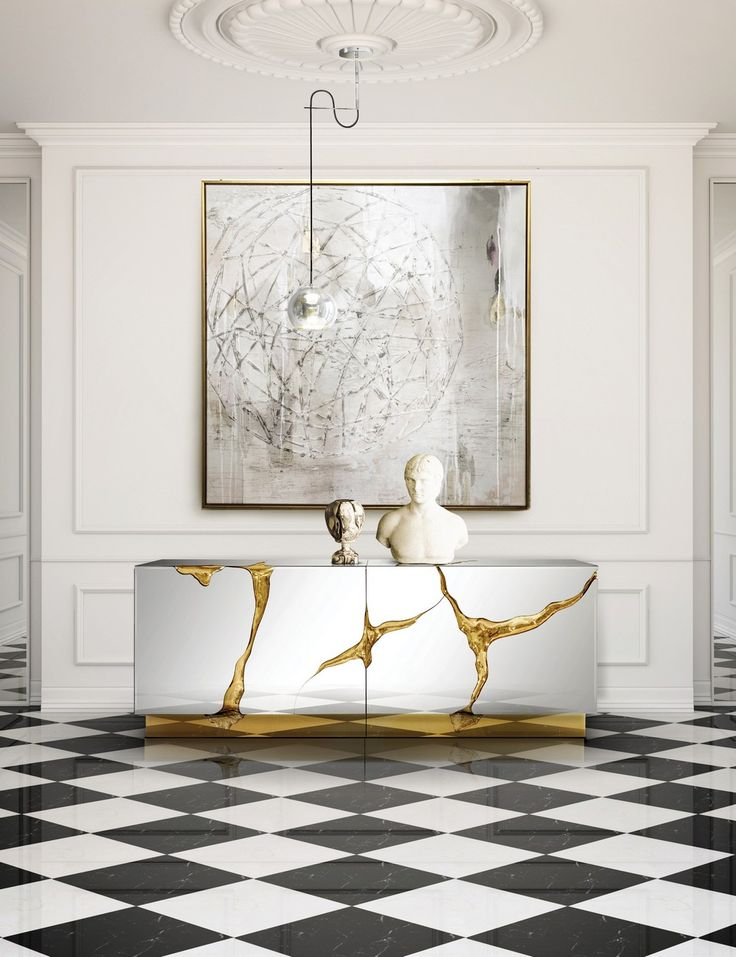 Consisting of two individual modules, the Lapiaz is finished in polished stainless steel that portarys a perfect mirror, with a poplar root wood veneer interior | www.bocadolobo.com #bocadolobo #luxuryfurniture #exclusivedesign #interiodesign #designideas