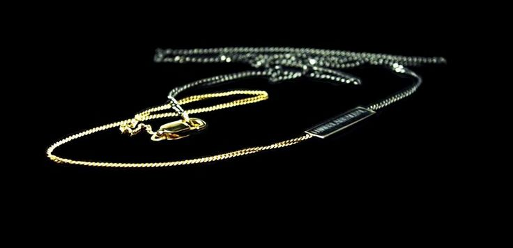 18 K Gold Necklace. Oxidised silver and brilliant cut diamond.