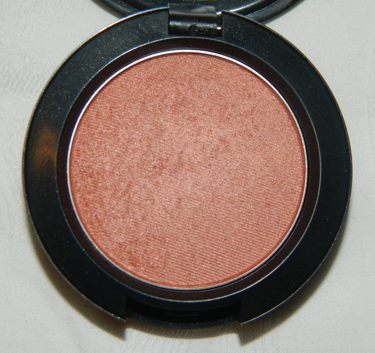 MAC Margin Powder Blush...A dirty peach color with shimmer that looks good on any skin tone.