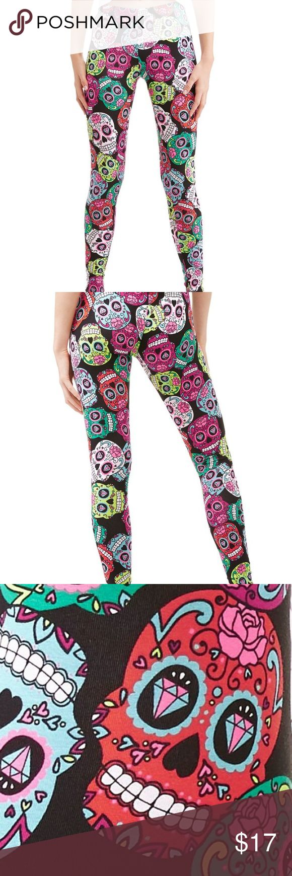 "NEW Sugar Skull Day Of The Dead Leggings XL 15-17 I love these leggings! They're so colorful. Made of 95% Cotton, 5% Spandex, so there's lots of stretch. Colors are black background with multi bright colors of pink, fuchsia, aqua, teal, yellow and white. Beautiful combination that really works. Perfect for Halloween! I'm keeping a pair for myself and these will be my ""costume"" this year! Size XL (15-17) NOBO Pants Leggings"