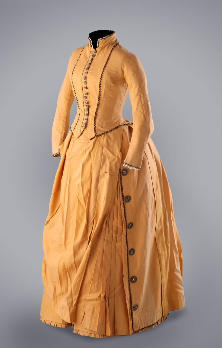 1880s Mustard Day Dress, beaded trim along the bodice seams and skirt edges. Also decorative detailed buttons along skirt edge.