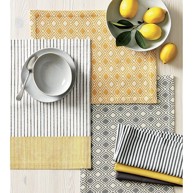 Crate & Barrel: Zahara Grey Placemat and Fete Dove Napkin | Crate and Barrel