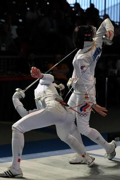 Silver Roumanie (left) against Tatiana Logunova (I think), at the 2012 European Fencing Championships!
