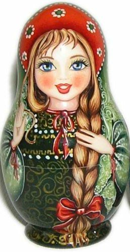 Matryoshka (Russian nesting doll) in beautiful kokoshnik (a headdress) with a long plait.