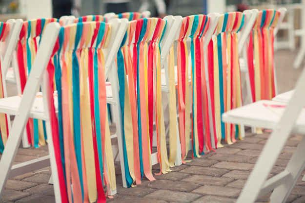 I adore these ribbon ties on the backs of outdoor wedding chairs. Use your wedding colors and get everyone in on the project-including dad!