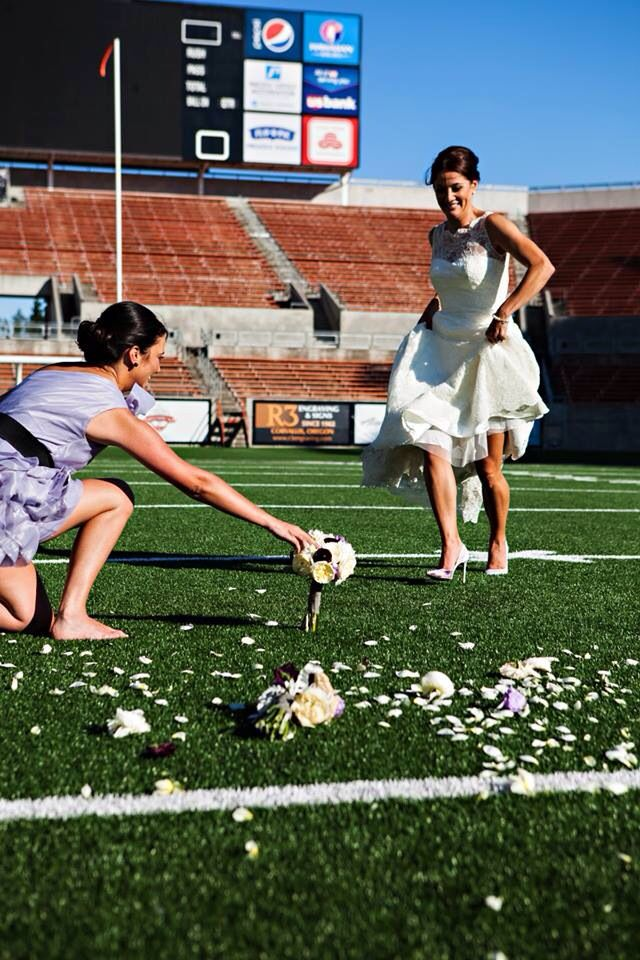 This picture really suited my personality. Decided to punt my bouquet. Couldn't have a more football picture #footballwedding #football #atelierpictures  Sports wedding. NFL.