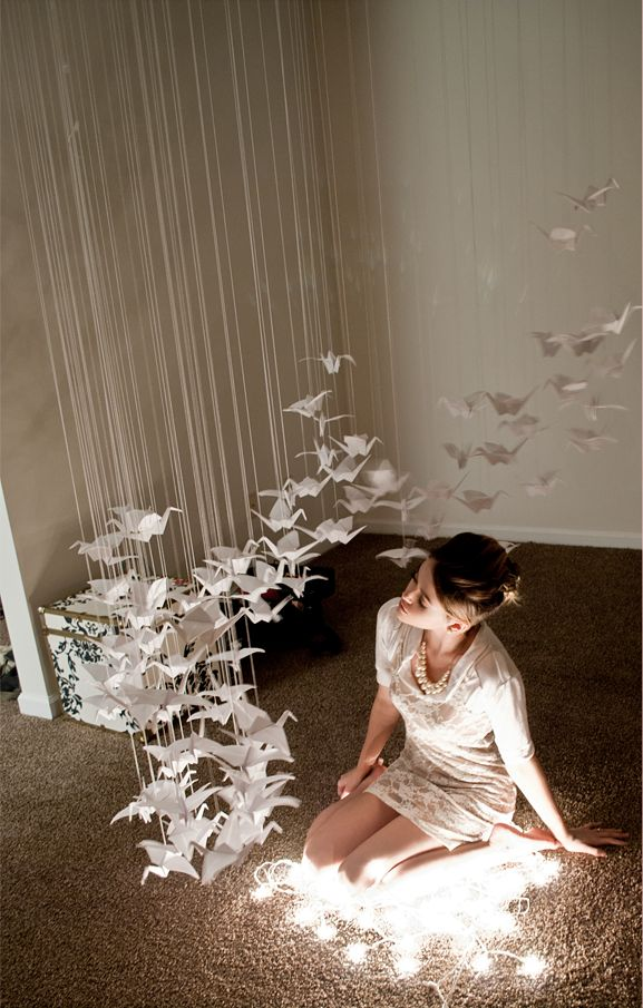 What a beautiful installation of origami cranes for a serene and contemplative abode.