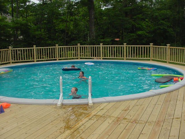 Deck railings around above ground pools free standing for Deck from house to above ground pool
