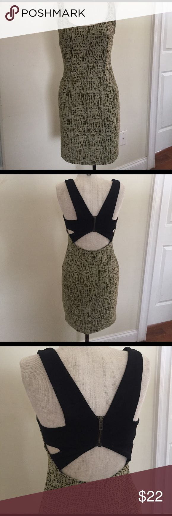 Patterned gold dress with cut out and zipper back Fun sparkly gold patterned dress with black cutout and zipper detail back. short and sexy size tag is ripped but it definitely fits as an xs Dresses Mini