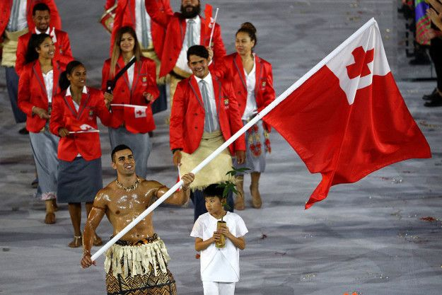 Then we got to T. Tanzania… Timor Leste… Togo…. TONGA!!! | Guys We Need To Talk About Tonga's Hot Oiled Up Flag Bearer