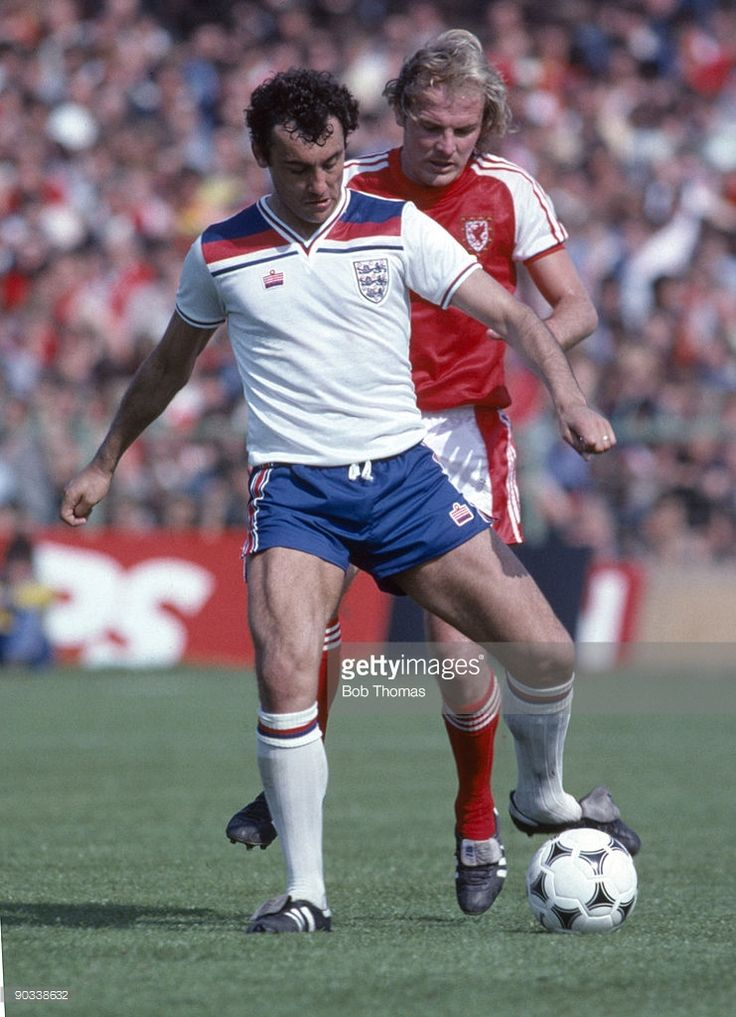 Ray Kennedy of England with Terry Yorath of Wales during the England v Wales British Championship...