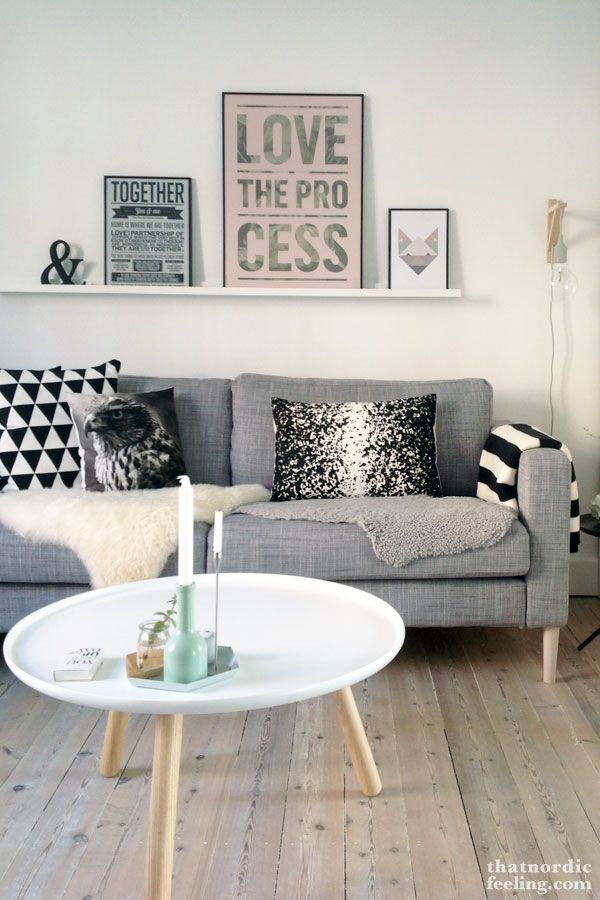 Love the wooden floor with this Scandinavian interior. Very simple, featuring the faux fur and angled leg coffee table. FAVOURITE: - Typography artwork - Coffee table - Candles and subtle colour centre piece
