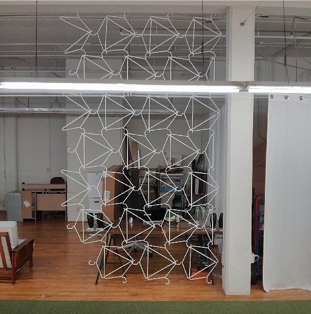 awesome, awesome DIY room divider -- made of simple wire hangers!! -- project and photo by @Mike Tucker Tucker Tucker Tucker Tucker Tucker Tucker McCaffrey