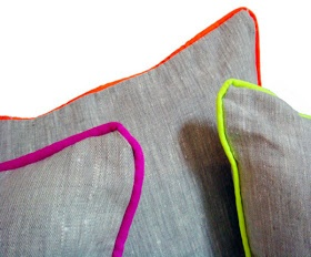 Great idea for pop of colour. Grey cushion with neon edge piping