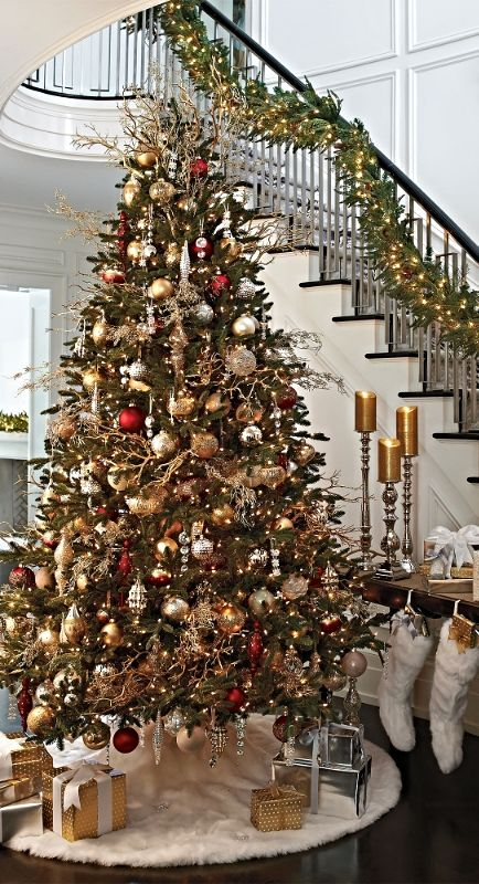 Gold, cream and a classic red are the primary colors in our elegant Donatella 60-piece Ornament Collection.: