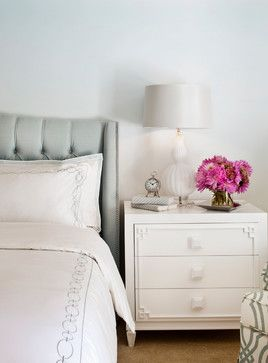 beautiful clean lines and classic patterns in this light and airy baster bedroom.