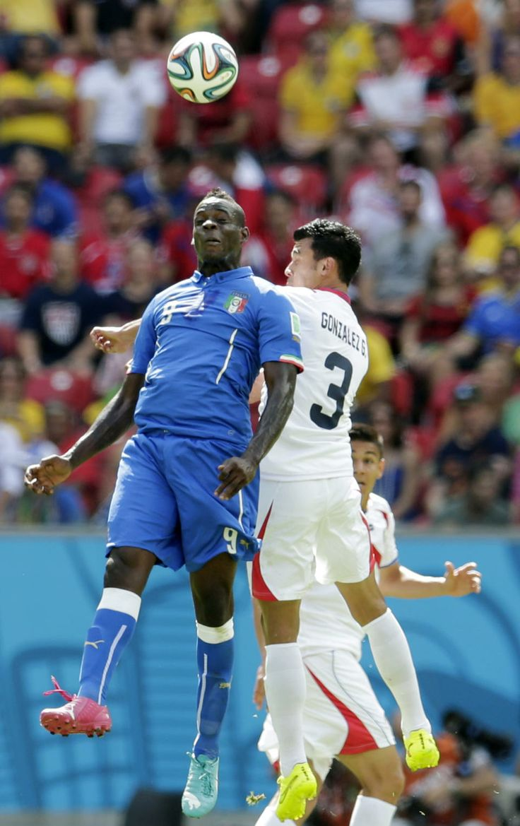 Costa Rica continues to surprise by beating Italy - Italy's Mario Balotelli, left, and Costa Rica's Giancarlo Gonzalez head the ball during the group D World Cup soccer match between Italy and Costa Rica at the Arena Pernambuco in Recife, Brazil, Friday, June 20, 2014. (AP Photo/Petr David Josek)
