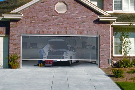 Roll up garage door screen more information on our for Roll down garage door screen