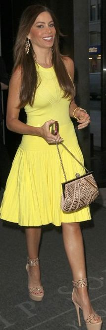 Who made Sofía Vergara's yellow pleated dress and nude crystal sandals? Shoes – Yves Saint Laurent  Dress – Tart