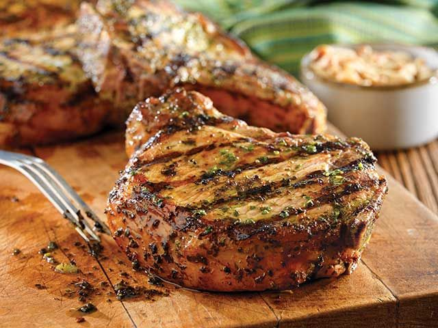 So fresh, so simple + so flavorful – make these Grilled Pork Chops w/ Basil Garlic Rub for your summer cookouts.