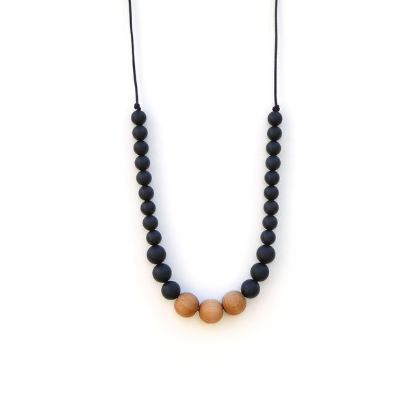 This Naturalist wood silicone black teething necklace is the epitome of style. The round maple wood beads added extra touch of style without sacrificing functionality.