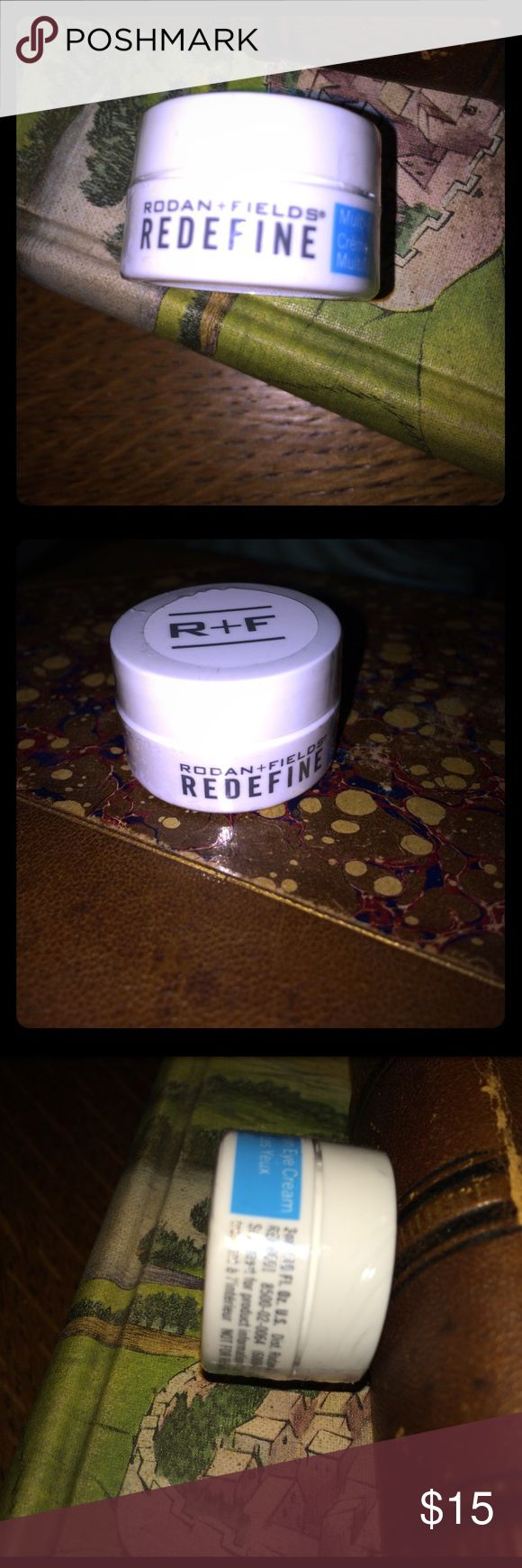 Rodan Fields Redefine Mini Eye Cream 3ml 10oz Rodan Fields Redefine Mini Eye Cream 3ml 10oz.  New, sealed.   REDEFINE Mini Multi-Function Eye Cream combines powerful peptides to minimize the appearance of crow's-feet, helps reduce the appearance of both puffiness and dark under eye circles while special optical diffusers noticeably brighten the eye area. This formula is ideal for maintaining the delicate skin around the eyes. 3mL rodan fields Makeup