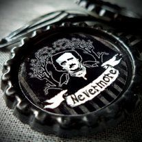 """The """"Nevermore"""" hair clips feature the one & only Master of Macabre, Edgar Allen Poe. The image is attached to a flat bottle cap & sealed with an epoxy resin for protection. Black snap clips are attached for easy wear. These are sold in sets of two.  Be sure to check out my other accessories fe..."""