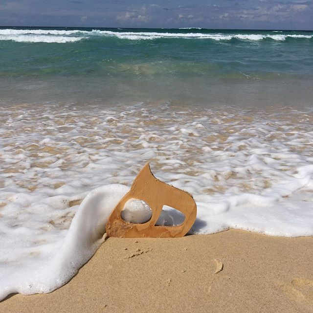 Wave sand and letter at Tuncurry beach