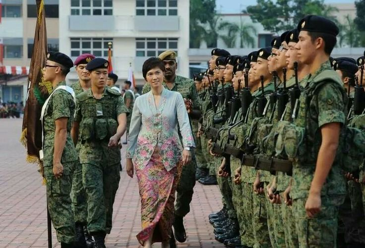 A Singaporean Lady Minister viewing the Guard of Honour..proud of her Peranakan heritage..wears her sarong kebaya !