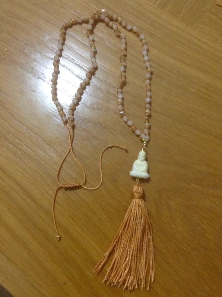 Rosary with cream crystals, buds and tassel