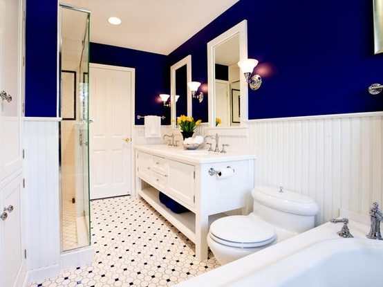 Cobalt blue & white bathroom with twin basins & tongue-and-groove dado