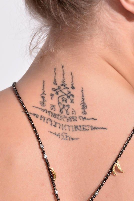 Cara Delevingne Khmer neck tattoo