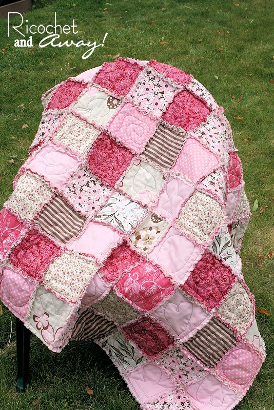 Love everything about this rag quilt... colors, random colors, random designs on blocks, and the ...