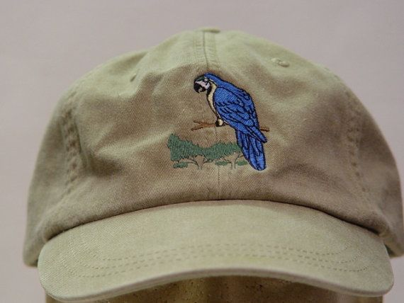 NEW EMBROIDERED BLUE MACAW BIRD WILDLIFE HAT (HATS SHOWN ARE KHAKI AND HOT PINK) Adams Optimum 6 Panel Baseball Hat  Low Profile – 100% Cotton Twill Adult Cap  Pigment Dyed – Garment Washed Hat  6 Panels with Sewn Matching Eyelet  Visor with 3 Rows of Stitching  Pre-formed Bill - Leather Strap with Brass Grommet  Adjustable – One Size Fits Most  An Extremely Comfortable Baseball Hat!  Enjoy the Embroidered Blue Macaw Bird Hat!  We have 24 Different Solid Color Baseball Hats Available Please…