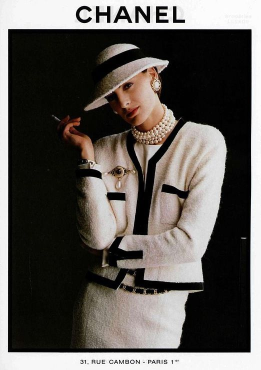 Vintage Chanel Suit worn with choker Pearls and brooch. Brooches and Pins are in fashion this season.