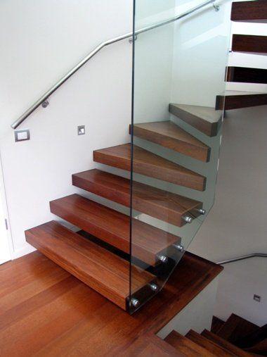 Floating Kwila steel stairs with glass balustrade