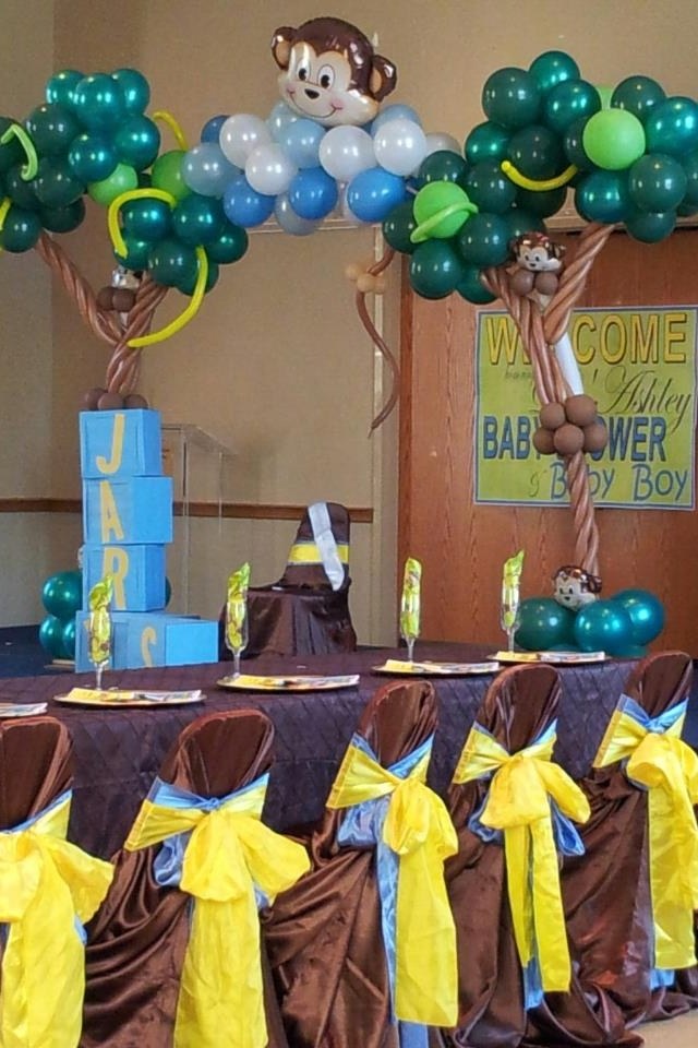 awesome balloon trees. we could make the chairs snazzy too.  Monkey baby shower by creative events
