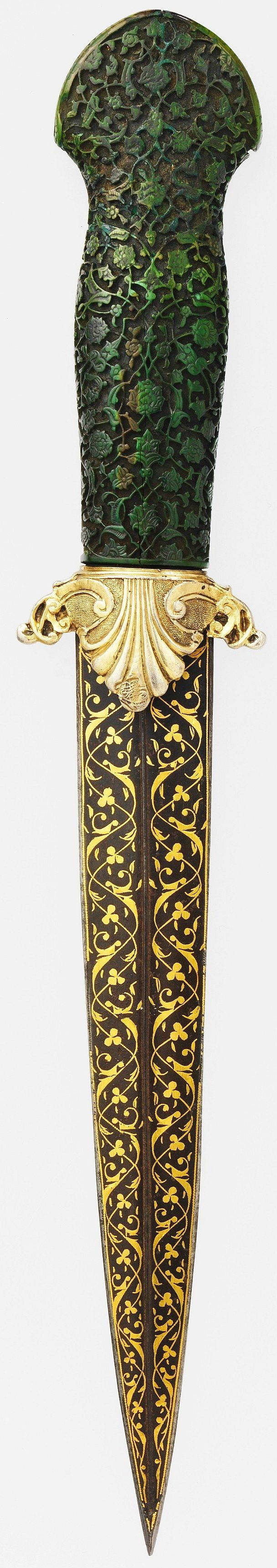 "Ottoman dagger, 16th c (grip and blade), guard 1774–89, steel, ivory, gold; silver-gilt, L. 12 1/4 in. (31.12 cm); blade L. 7 1/2 in. (19.1 cm), Met Museum, Bequest of George C. Stone, 1935. The ivory grip is carved in the manner of objects made for the Ottoman court, blade inscribed in Turkish and Persian (Ottoman court languages) ""I besought a drink of water from your trenchant dagger, what if but once you should let me drink, what would you lose? If I thirst, his dagger is not laid down""."